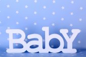 Word baby on blue background — Stockfoto