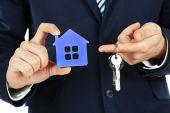 Businessman hands with keys and model of house, closeup — Stock Photo