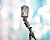 Retro microphone on bright blurred background — Stockfoto