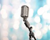 Retro microphone on bright blurred background — Stock Photo
