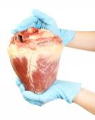 Hands holding raw animal heart isolated on white — Stock Photo