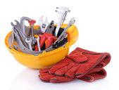Construction tools i hjälm på nära håll — Stockfoto