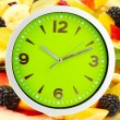 Food clock with fruits as background. Healthy food concept — Stock Photo #71537853