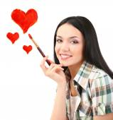 Beautiful young woman as painter with brush and red hearts isolated on white — Стоковое фото