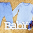 Clothes for baby boy on colorful background — Stock Photo #71541087