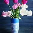 Beautiful tulips on wooden background — Stock Photo #71542639