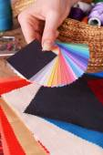 Samples of colorful fabric in female hand, closeup — Stock Photo