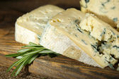 Blue cheese on wooden cutting board — Stock Photo