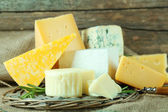 Different sort of cheese on wicker tray, closeup — Stock Photo