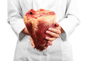 Woman holding raw animal heart — Stock Photo