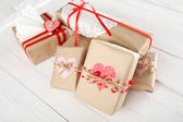 Beautiful gift boxes on wooden background. Valentine Day concept — ストック写真