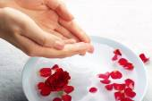 Female hands with bowl of aroma spa water on table, closeup — Stock Photo