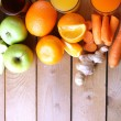 Assortment of healthy fresh juices on wooden table background — Stock Photo #71561943