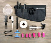 Hairdressing tools on wooden background — Stock Photo