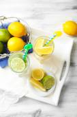 Cocktails with fresh citrus fruits on wooden background — Stock Photo