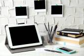 Stylish workplace with digital tablet at home or studio — Stok fotoğraf