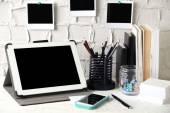 Stylish workplace with digital tablet at home or studio — Zdjęcie stockowe