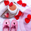 Spa bowl with water, rose petals, towel and slippers on light background. Concept of pedicure or natural spa treatment — Stock Photo #71792853