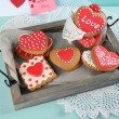 Heart shaped cookies for valentines day on tray, on color wooden background — Stock Photo #71792931