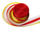 Colorful red and yellow ribbons isolated on white — Stock Photo