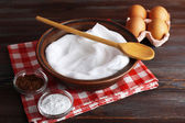 Whipped egg whites and other ingredients for cream on wooden table, closeup — Stock Photo