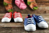 Colorful toddler shoes on wooden background — Stock Photo