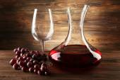 Glass carafe of wine on wooden background — Stock Photo