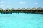 Villas over ocean background — Stockfoto