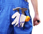 Man in coveralls with tools in his pocket isolated on white — Stock Photo
