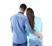 Back view of young couple isolated on white — Stock Photo