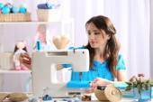 Beautiful young needlewoman in workshop — Stock Photo