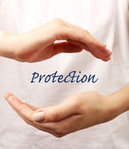 Female hands with word protection on light background — Stock Photo