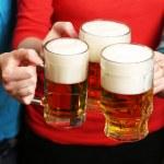 Beer in female hands, closeup — Stock Photo #71811169