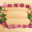 Frame of beautiful dry flowers on wooden background — Stock Photo #71812137