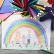Kids drawing on white sheet of paper on wooden table, top view — Stock Photo #71814403
