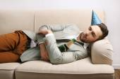 Young man on couch after fun close up — ストック写真