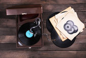 Gramophone with a vinyl record on wooden table, top view — Stock Photo