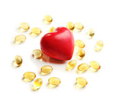 Red heart and cod liver oil, isolated on white — Stock Photo