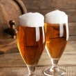 Glasses of beer on wooden background — Stock Photo #71948339