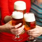 Beer in female hands, closeup — Stock Photo #71948675