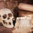 Still life with human skull, retro letter and candlelight on wooden table, closeup — Stock Photo #72145159