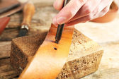 Repairing leather belt in workshop — Stock Photo