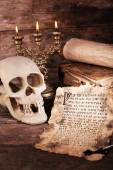 Still life with human skull, retro letter and candlelight on wooden table, closeup — Fotografia Stock