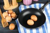 Still life with eggs and pan — Stock Photo