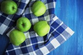Green apples on squared fabric, closeup — Stock Photo