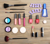 Various cosmetics on wooden background — Stock Photo
