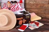 Packed suitcase of vacation items — Stock Photo
