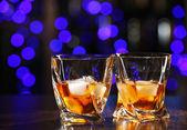 Glasses of whiskey on bar background — Stock Photo