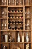 Shelving with wine bottles — Stock Photo