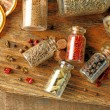 Spices in glass bottles — Stock Photo #72162349